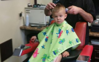 tristan cutting a young kids hair